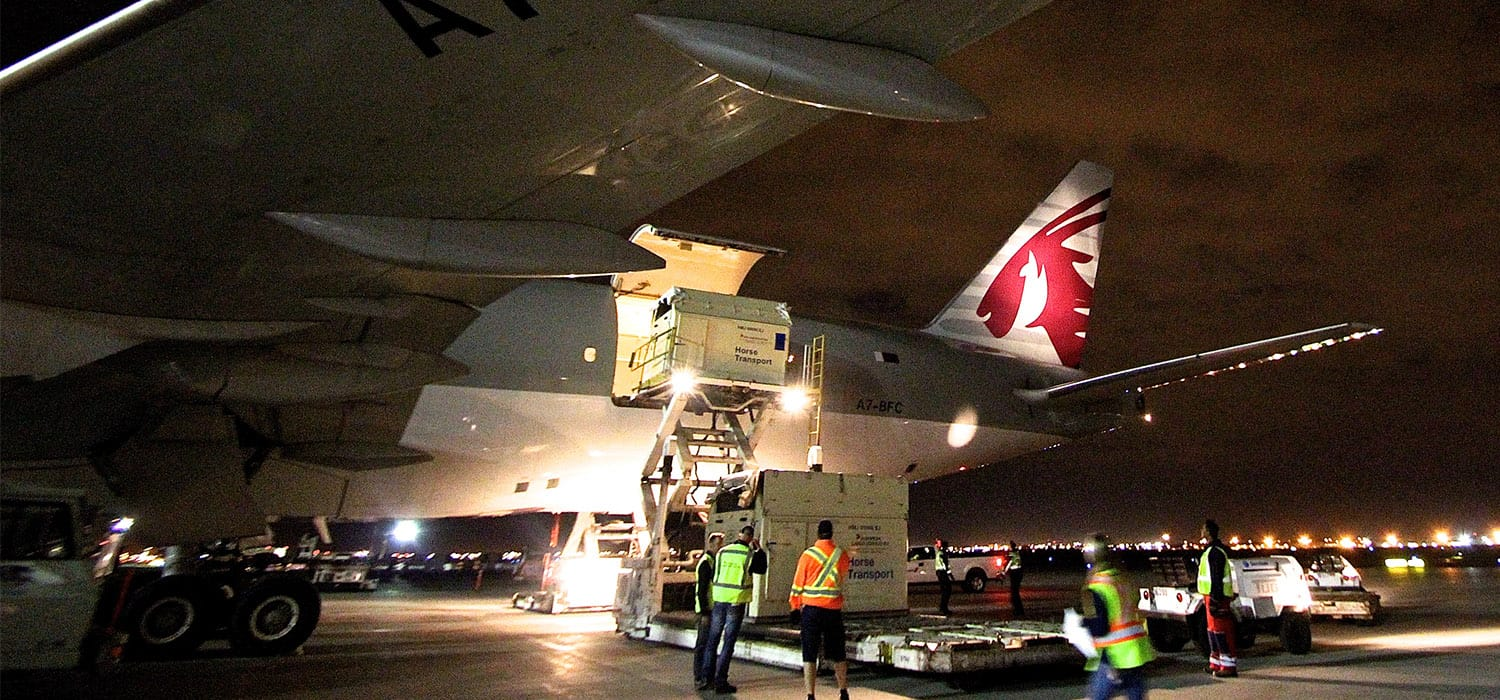 container being unloaded from a plane